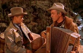 "Jimmy Stewart in ""Night Passage"" with accordion dubbed by Carl Fortina"