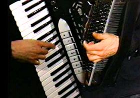 Nick Ariondo's hands on accordion.