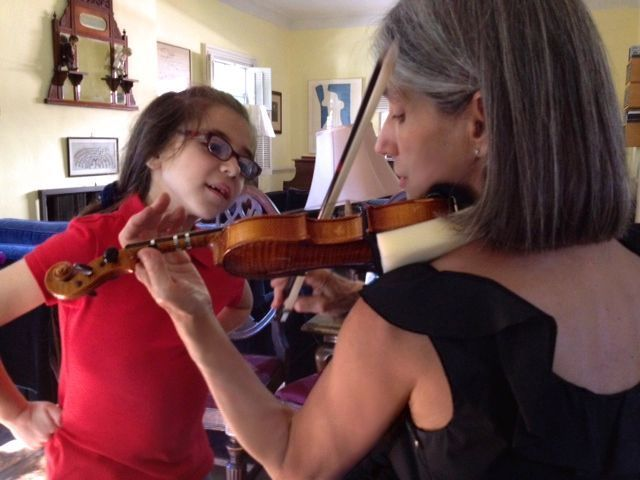 Serena loves learning violin from Constance, shown here during a lesson in her Beverly Hills violin studio.