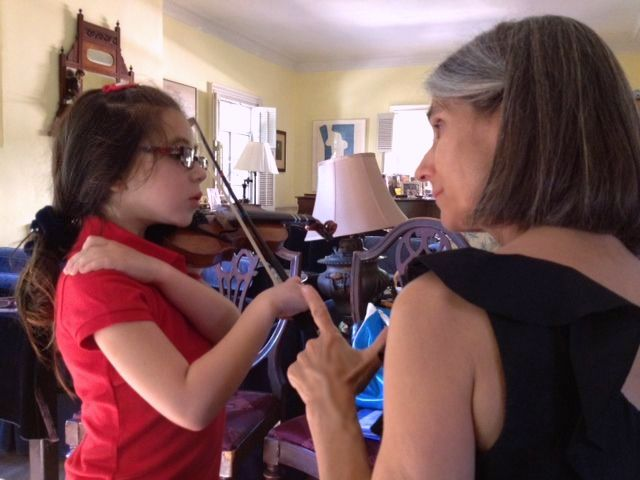 Serena participates actively during a Suzuki method violin lesson in Constance's Beverly Hills violin studio.