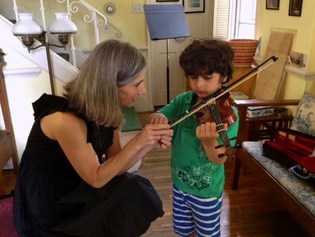 Violin student Tristan takes in the lovely techniques shown him by his Suzuki method teacher Constance during his violin lessons at her Beverly Hills violin studio.