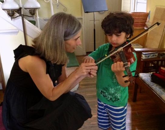 Violin student Tristan takes in the lovely techniques shown him by his teacher Constance during his violin lessons at her Beverly Hills violin studio.