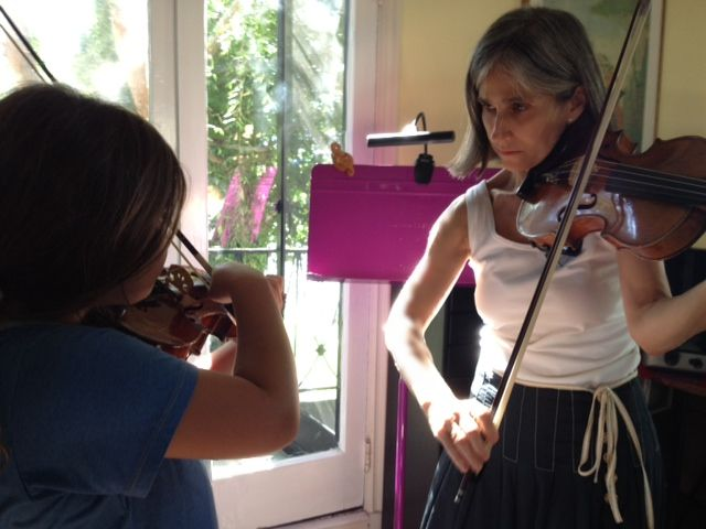 "Young Beverly Hills violin student Zoe loves her Suzuki method violin lessons with her teacher Constance, author of the widely-read Los Angeles Times article about the Suzuki method ""The Mom-centric method."""