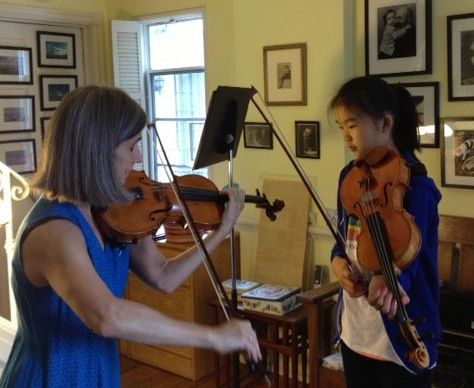 Beverly Hills violin teacher Constance Meyer gives a violin lesson to student Ella.